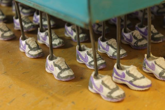 "Image 1 - Centipede; found key organizer, plastic ken doll shoes, acrylic and hot glue; 27"" x 18"" x 12""; 2016"